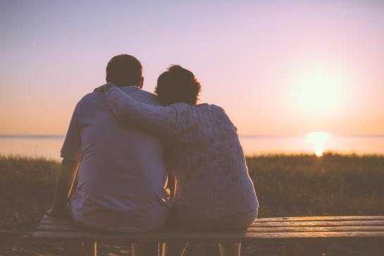 Senior couple enjoy the sunset together